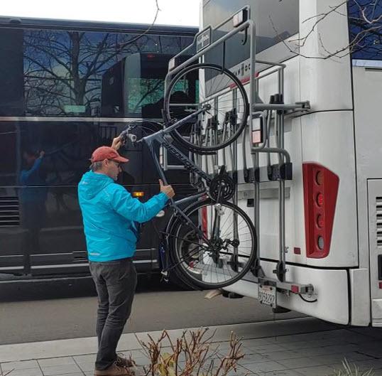 WeDriveU loading bike on shuttle bike safety